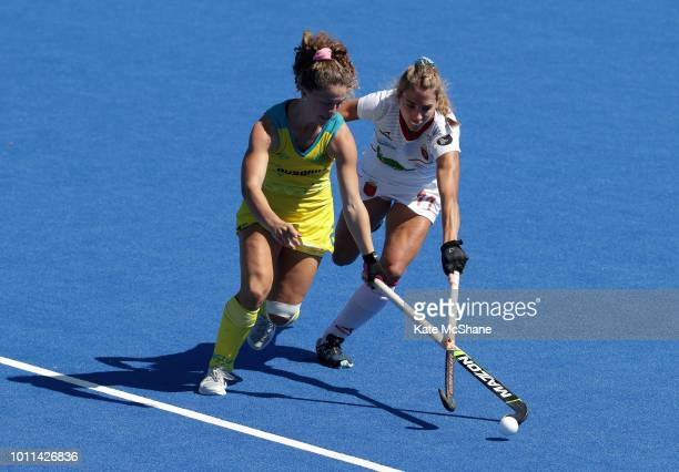 Ambrosia Malone of Australia and Cristina Guinea of Spain battle for the ball during the FIH Womens Hockey World Cup Third Place Play Off game...