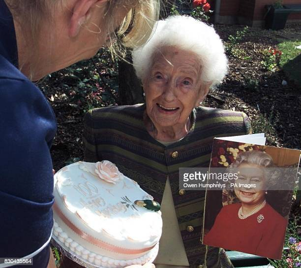 Ambrosine Nielsen from Jarrow in Tyne and Wear is presented with a birthday cake as she celebrates her 100th birthday with a telegram from the Queen...