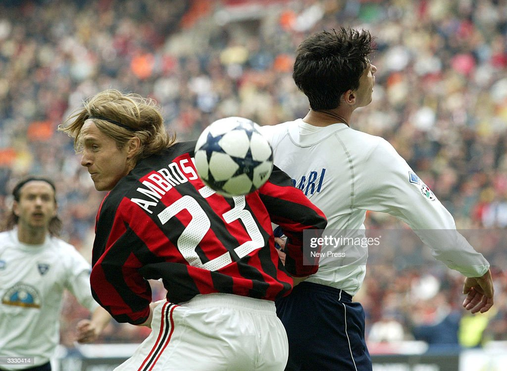 Ambrosini and Cribari in action during the Serie A match between Milan and Empoli April 10, 2004 in Milan, Italy.