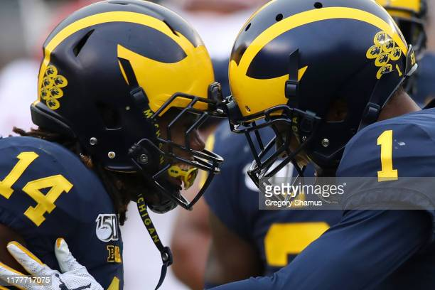 Ambry Thomas of the Michigan Wolverines celebrates a third quarter fourth down stop with Josh Metellus while playing the Rutgers Scarlet Knights at...