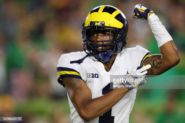 Ambry Thomas of the Michigan Wolverines celebrates after returning a kickoff for a touchdown in the second quarter at Notre Dame Stadium on September...