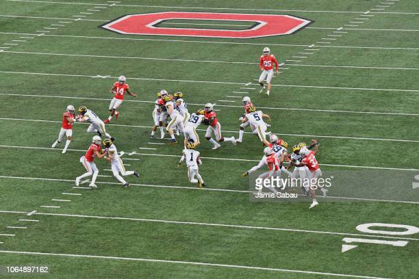 Ambry Thomas of the Michigan Wolverines returns the opening kickoff as Ohio State takes on Michigan at Ohio Stadium on November 24 2018 in Columbus...