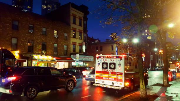 FDNY (Fire Department of New York) ambulance along Dekalb Avenue in Brooklyn, New York City