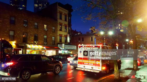 fdny (fire department of new york) ambulance along dekalb avenue in brooklyn, new york city - fake hospital stock pictures, royalty-free photos & images