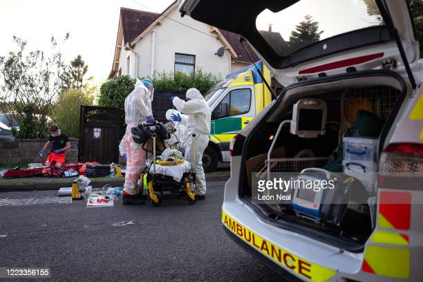 Ambulance and air ambulance crews work to stabilise a patient with possible COVID19 symptoms who was found unconscious having suffered a cardiac...