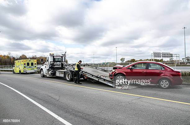 ambulance and towing - tow truck stock photos and pictures