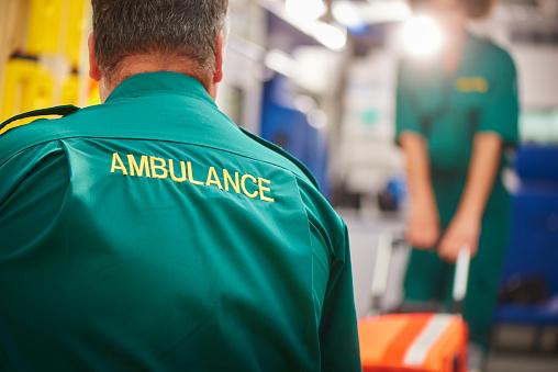 ambulance crew pulling stretcher 541852730