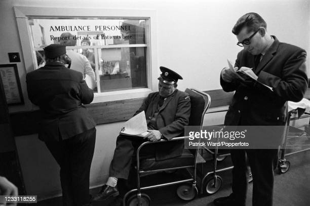 Ambulance crews signing in patients at Padddington Hospital in London, circa June 1969. From a series of images to illustrate the many frustrations...