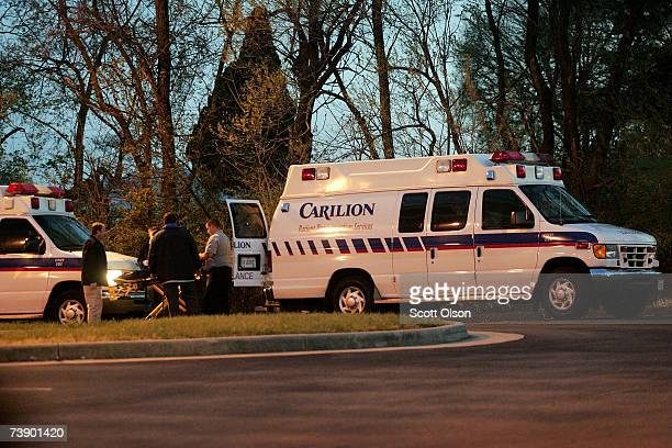Ambulance drivers pack their gear after dropping victims of the mass shooting at the southwestern Virginia University Virginia Tech at the Medical...