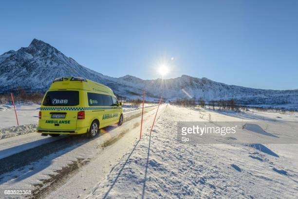 Ambulance driving in a winter landscape in Norther Norway