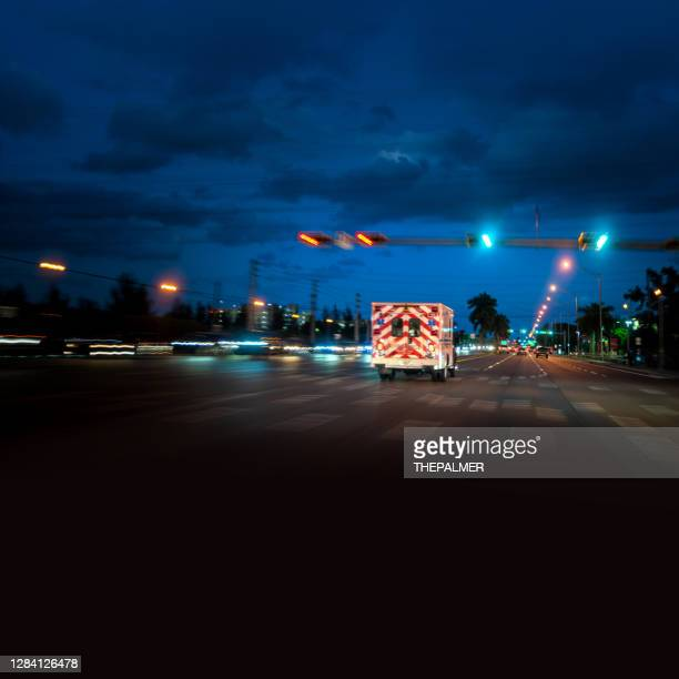 ambulance driving in miami - ambulance stock pictures, royalty-free photos & images