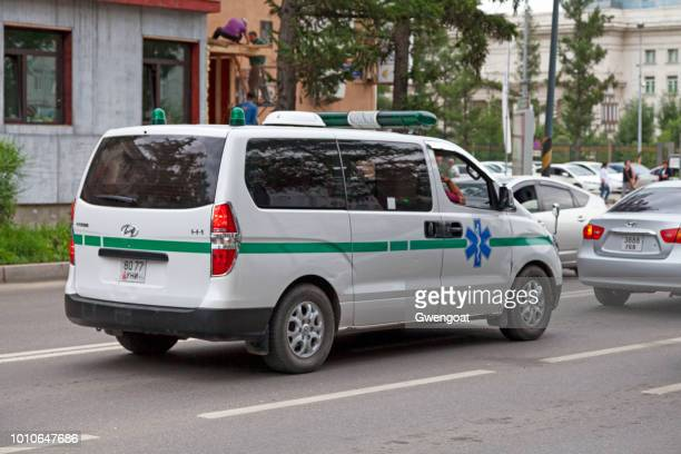 ambulance driving in ulan bator - gwengoat stock pictures, royalty-free photos & images