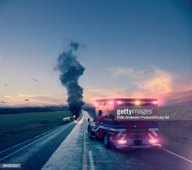 ambulance driving to car crash - crash photos stock-fotos und bilder
