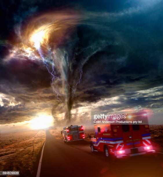 Ambulance driving to tornado in desert