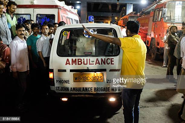Ambulance getting ready to take a victim of the collapse of an overpass under construiction to the hospital in Kolkata India in March 31st 2016