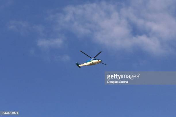 ambulance helicopter providing air medical services - helicopter rotors stock photos and pictures