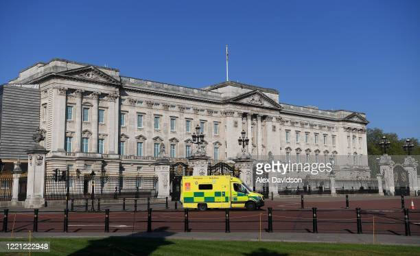 Ambulance is seen parked up outside Buckingham Palace on April 26 2020 in London England The British government has extended the lockdown...