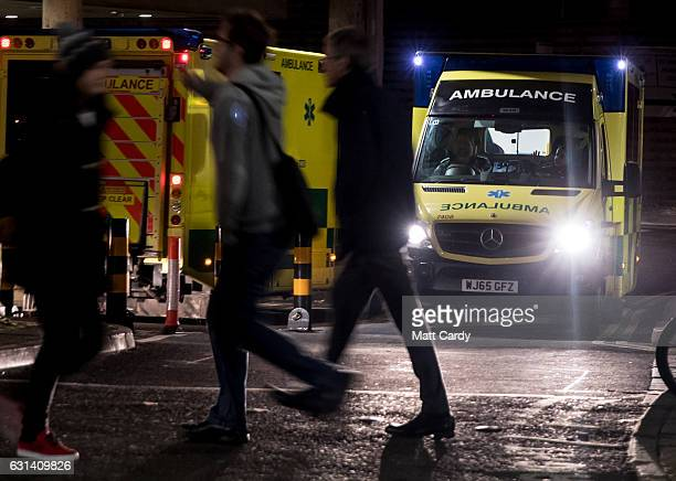 A ambulance leaves as another one arrives at the Accident and Emergency department of the Bristol Royal Infirmary on January 10 2017 in Bristol...