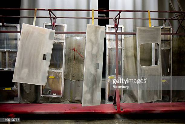 Ambulance module parts hang in a paint booth at the Horton Emergency Vehicles facility in Grove City Ohio US on Friday Aug 3 2012 Horton Emergency...