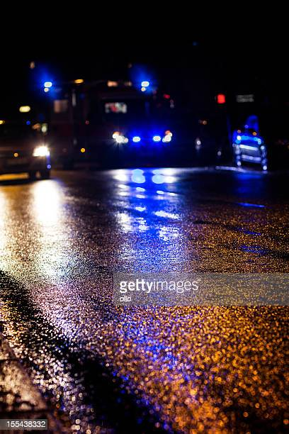 Ambulance, reflections on wet asphalt