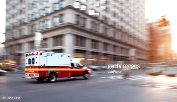ambulance respond to an emergency in downtown - state of emergency stock pictures, royalty-free photos & images