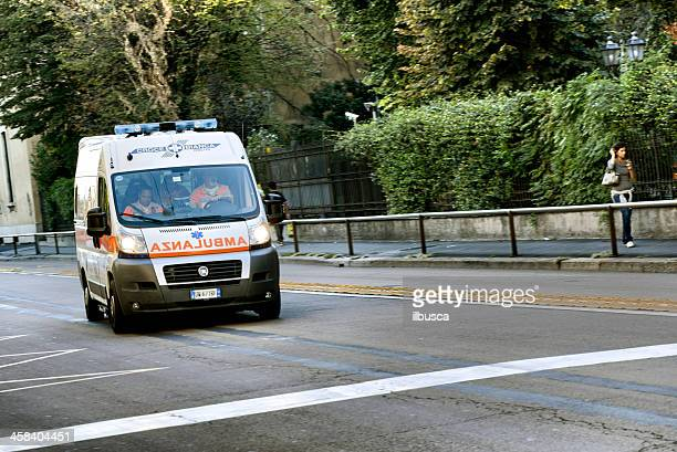 ambulance running fast in milan city centre street - ambulance stock pictures, royalty-free photos & images