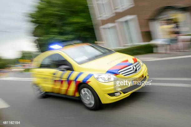 ambulance rushing to an accident at high speed - dutch culture stock photos and pictures