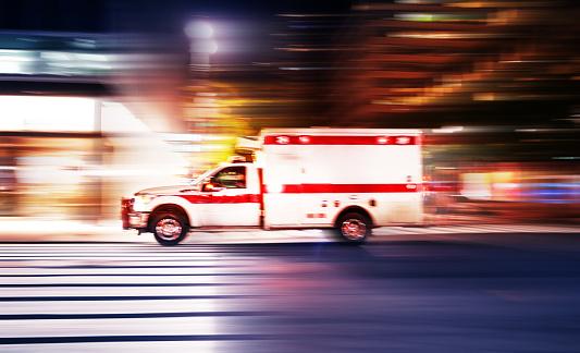 Ambulance speeding at night in New York City 1172760434