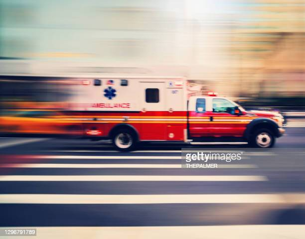 ambulance speeding in new york - ambulance stock pictures, royalty-free photos & images