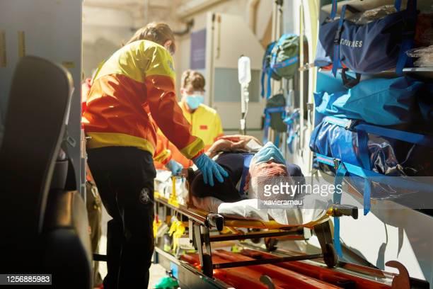 Ambulance Staff Moving Caucasian Senior Man on Stretcher