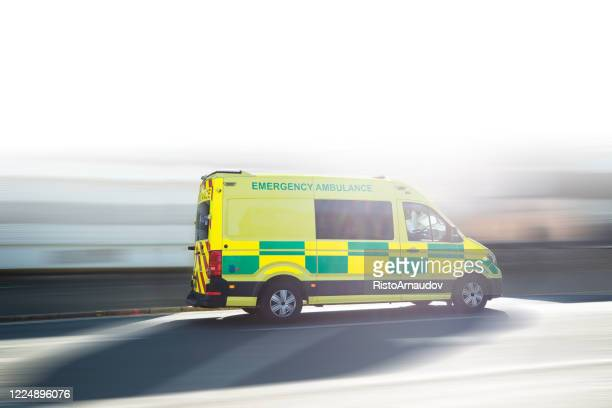 ambulance uk respond to an emergency in downtown - emergencies and disasters stock pictures, royalty-free photos & images