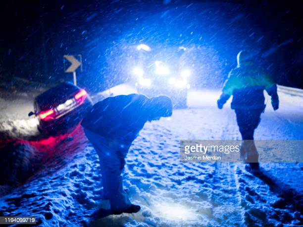 ambulance vehicle on winter night road - jasmin sturm stock-fotos und bilder