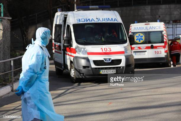 Ambulance vehicles and doctors are seen guarding near the hospital infectious ward downtown Kyiv Ukraine March 13 2020 Ukraine recorded its first...