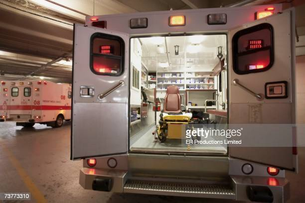 ambulance with back doors open - ambulance stock pictures, royalty-free photos & images