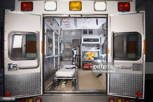 ambulance with rear doors open - ambulance stock pictures, royalty-free photos & images