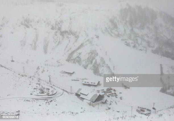Ambulances and fire vehicles are seen at a ski resort in Kusatsu town Gunma prefecture on January 23 after a volcano erupted earlier in the day A...