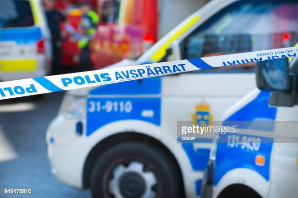 ambulances and police cars in stockholm, police line, do not cross - police force stock pictures, royalty-free photos & images