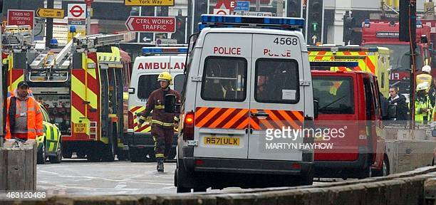 Ambulances and police vans stand at the ready in front of London's Kings Cross Station after a terrorist bomb exploded on the subway 07 July 2005 At...