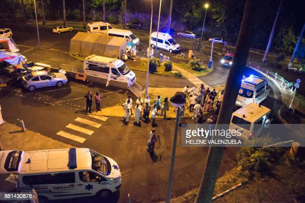 Ambulances are parked as patients and employees are being dispatched to other hospitals outside the University Hospital of PointeaPitre in the French...