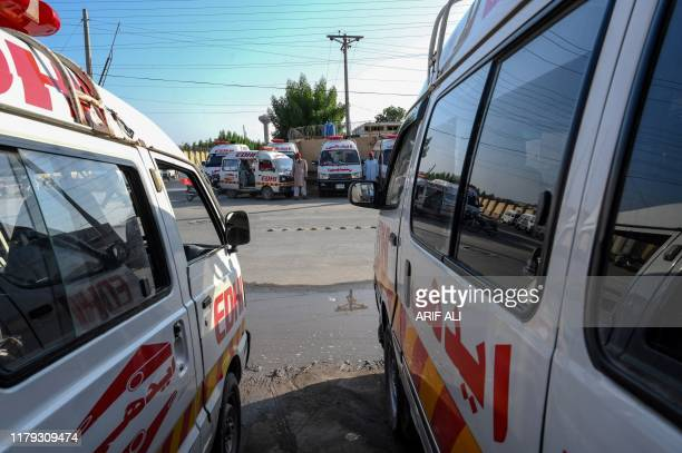 Ambulances are parked at a hospital in Rahim Yar Khan in Punjab Province on November 1 a day after a passenger train caught on fire killing people. -...