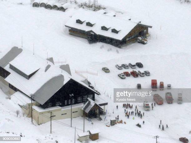 Ambulances are parked outside lodges after nearby Mt KusatsuShirane in Gunma Prefecture Japan erupts on Jan 23 2018 ==Kyodo