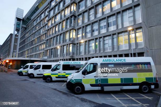 Ambulances are pictured outside Northwick Park Hospital in London on March 20 where they have declared a critical incident due to a surge in patients...