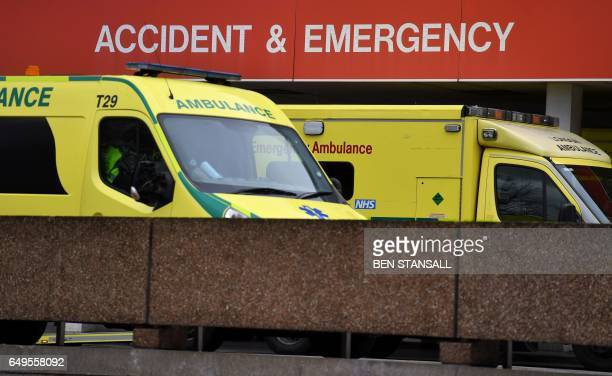 Ambulances are pictured outside the Accident Emergency department of St Thomas' Hospital in central London on March 8 2017 Britain's economy will...