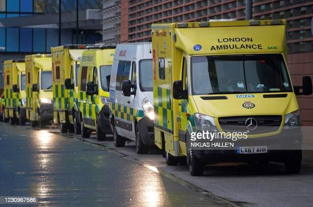 Ambulances are pictured parked outside the Royal London Hospital in east London on February 4, 2021. - More than 10 million people have received a...
