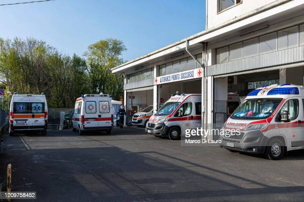 Ambulances are seen parked at the Italian Red Cross headquarters on April 5 2020 in Bergamo Italy The number of new COVID19 cases appears to be...