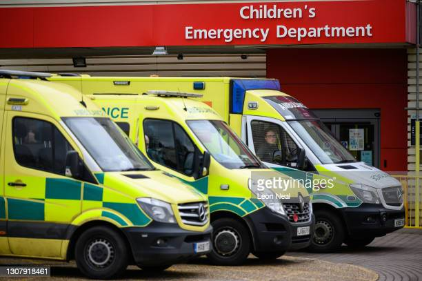 Ambulances are seen parked up outside the Children's Emergency Department of Milton Keynes University Hospital on March 19, 2021 in Milton Keynes,...