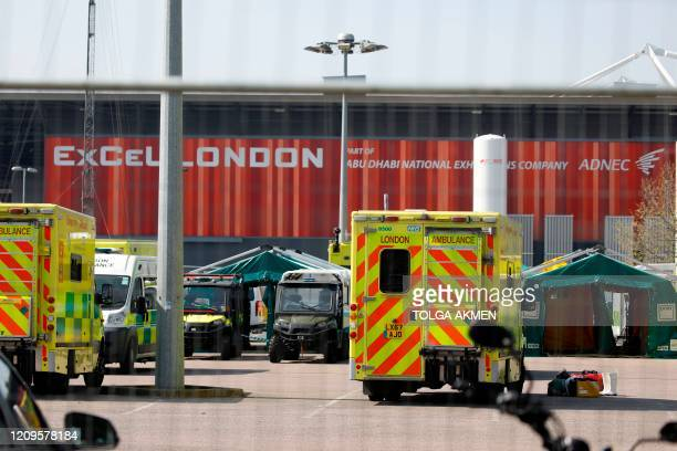 Ambulances are seen parked up outside the ExCeL London exhibition centre which has been transformed into the NHS Nightingale field hospital in London...