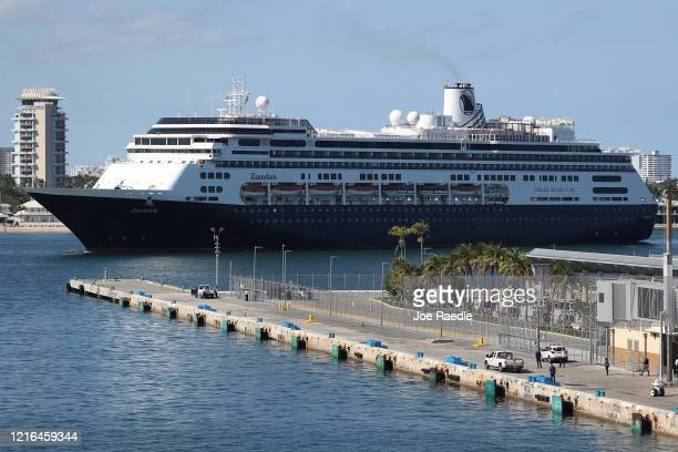 Ambulances are seen waiting as the Zaandam cruise ship pulls into Port Everglades on April 02 2020 in Fort Lauderdale Florida The Holland America...