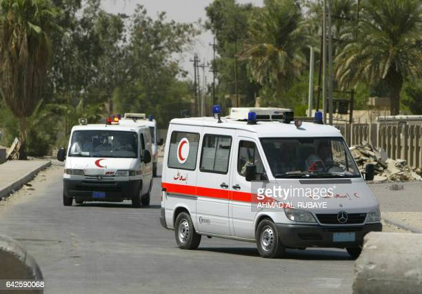 Ambulances arrive at Najaf General Hospital 06 August 2004 as intense clashes raged in the holy city between US forces and militiamen in the worst...