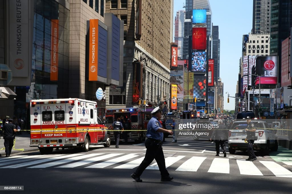 Ambulances arrive at the incident scene after it plowed into pedestrians on a busy sidewalk on the corner of West 45th St. and Broadway at Times Square, New York, NY United States on May 18, 2017. Multiple pedestrians were struck Thursday by a speeding vehicle in the heart of New York City, according to reports. At least 1 people dead and 19 others wounded.